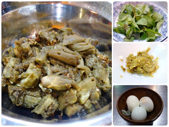 ส่วนประกอบของตำมะเขือยาวแบบชาวเหนือ ประกอบด้วยมะเขือเผา ใบสะระแหน่ น้ำพริกหนุ่ม และไข่ต้ม
